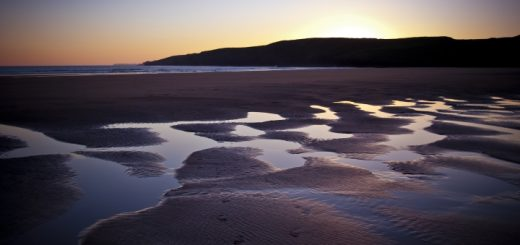 Pembrokeshire beach at dusk. Photograph by J K