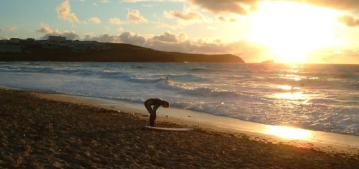 Surfer on beach at Newquay. Photograph by Ali Taylor