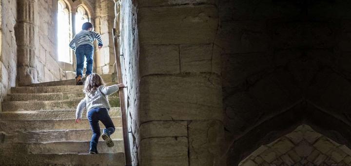 Children exploring an English Heritage castle